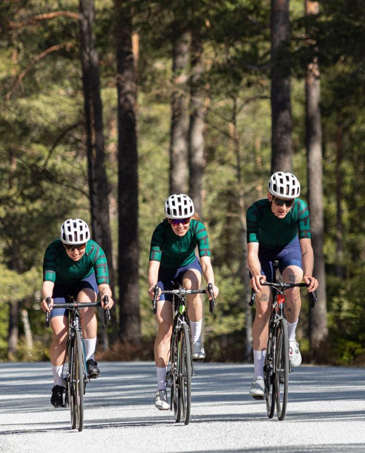 v2 green cycling jersey and blue bib shorts